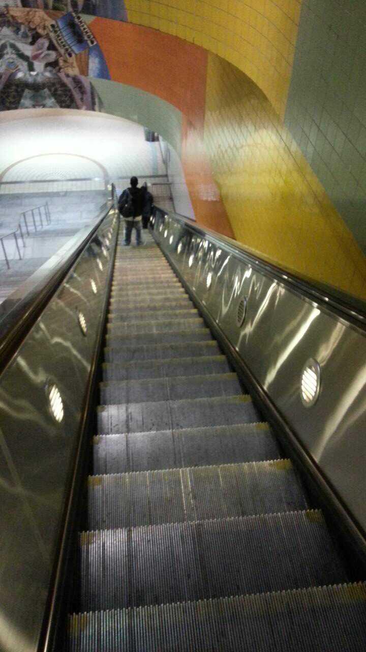 Looking down a long escalator